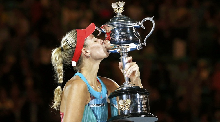 Germany's Kerber kisses the trophy after winning her final match against Williams of the U.S. at the Australian Open tennis tournament at Melbourne Park